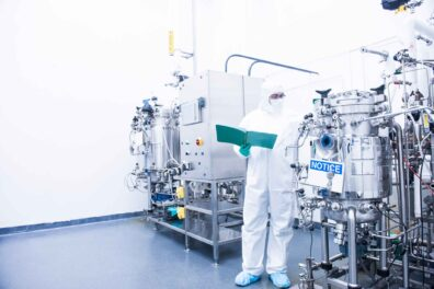 Man checking equipment in a cleanroom environment