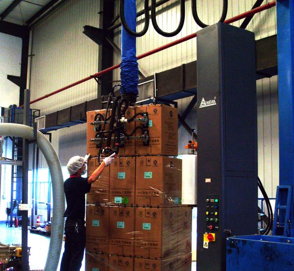 stacking boxes high on pallet with vacuum lifter