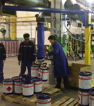 man lifting paint buckets using handheld vacuum lifter