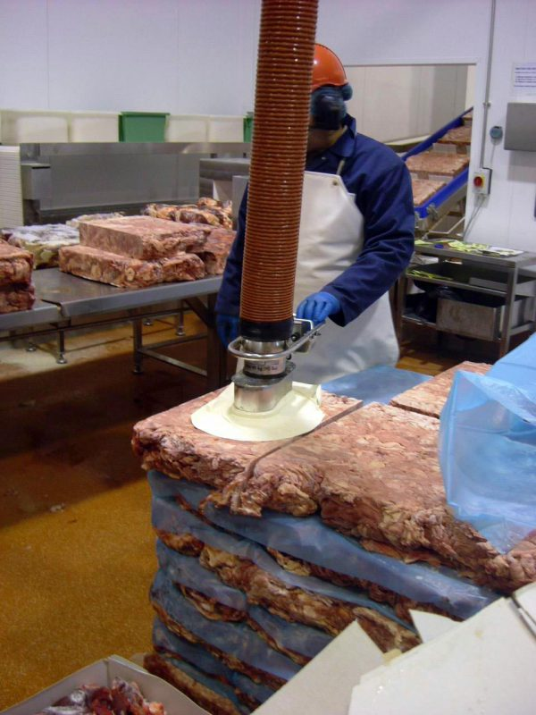 lifting unwrapped meat with stainless steel vacuum lifter