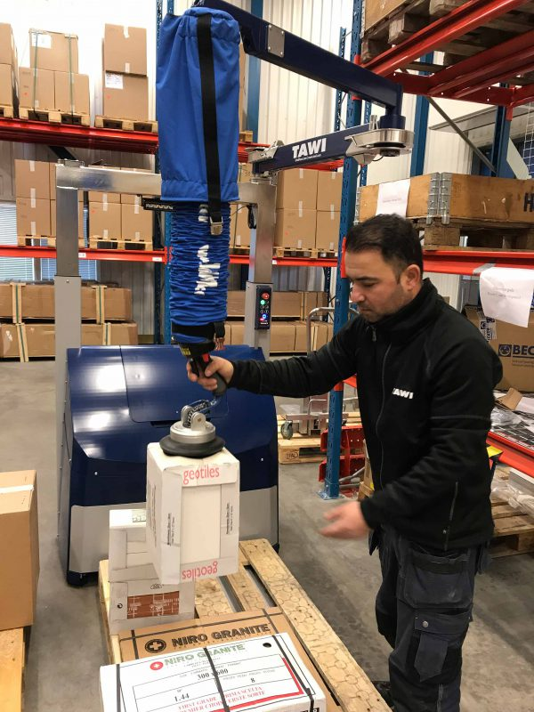 man lifting box with vacuum lifter on forklift