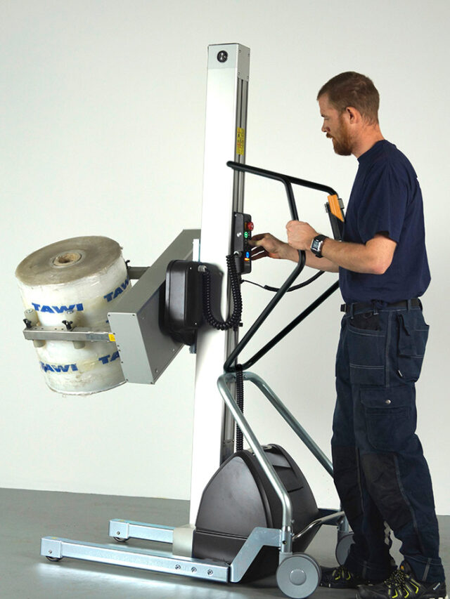 man lifting and turning roll in handhold lifting trolley
