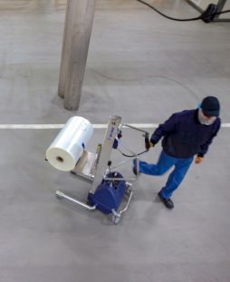 lifting trolley holding roll of packaging film