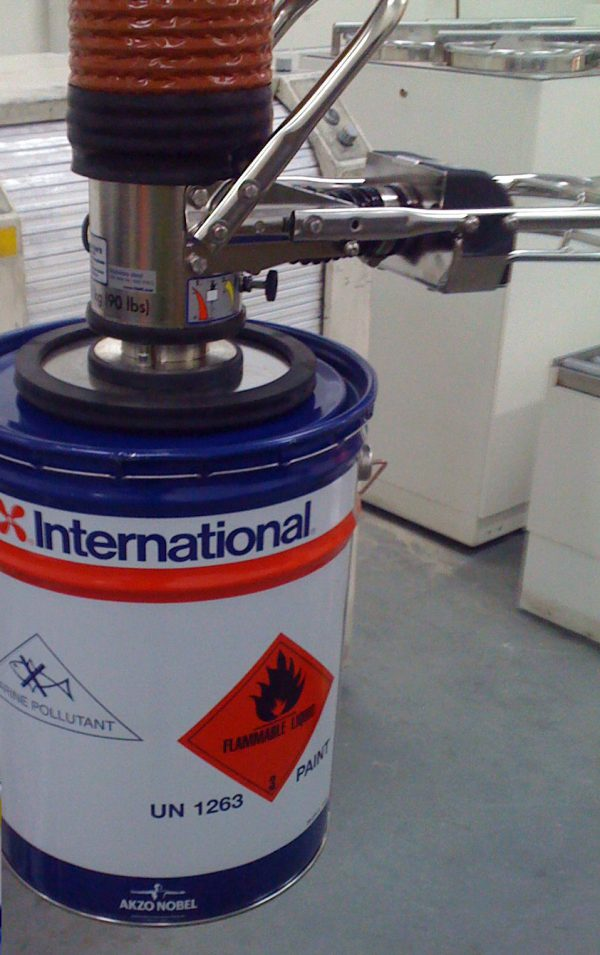 stainless steel ATEX vacuum lifter gripping drum from the top
