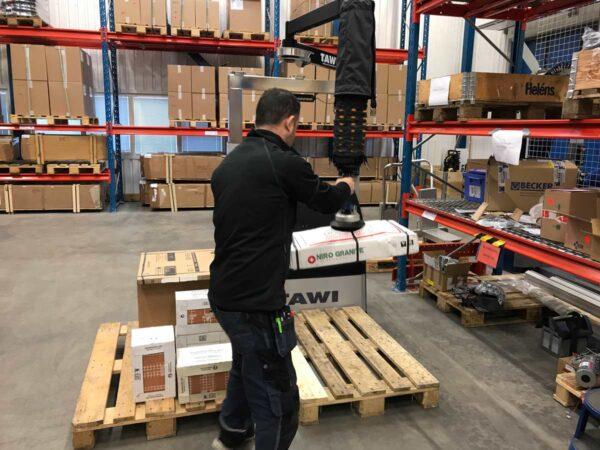 Man lifting box with ha