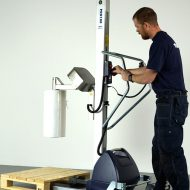 lifting roll with coregripper tool on lifting trolley