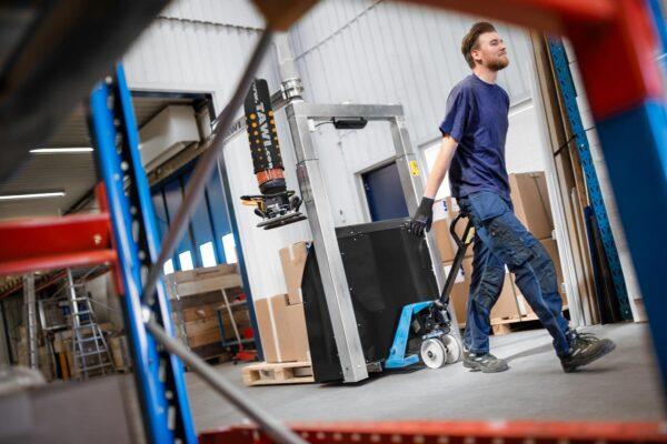 moving mobile order picker with pallet jack