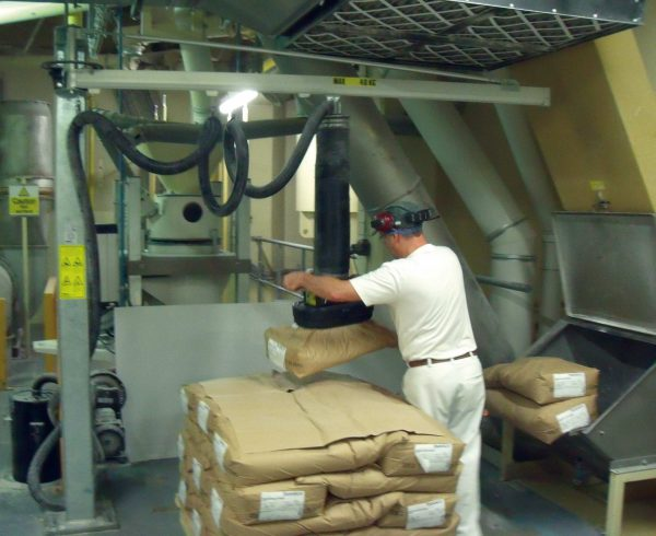Lifting sacks with flour