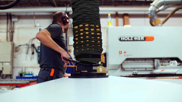 Lifting wooden sheets into CNC machine