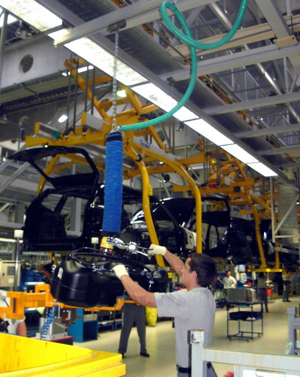 lifting car parts in automotive assembly line