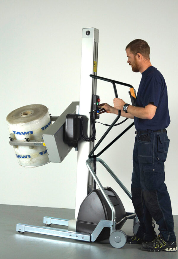 Man lifting and rotating roll with handhold lifting trolley