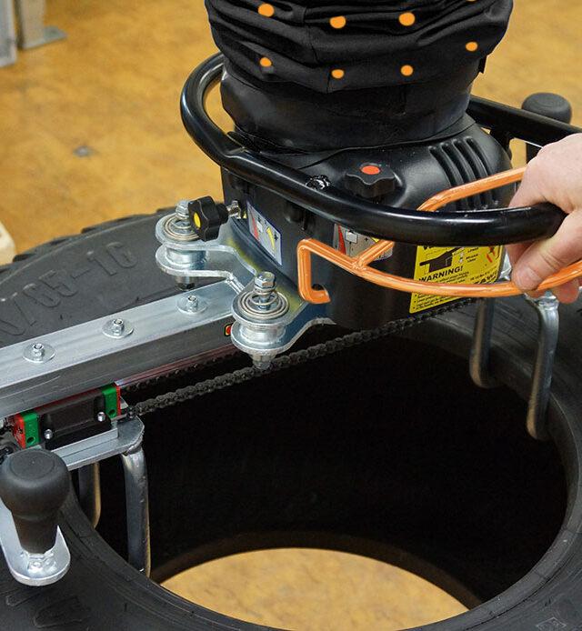Lifting tyre using handheld vacuum lifter
