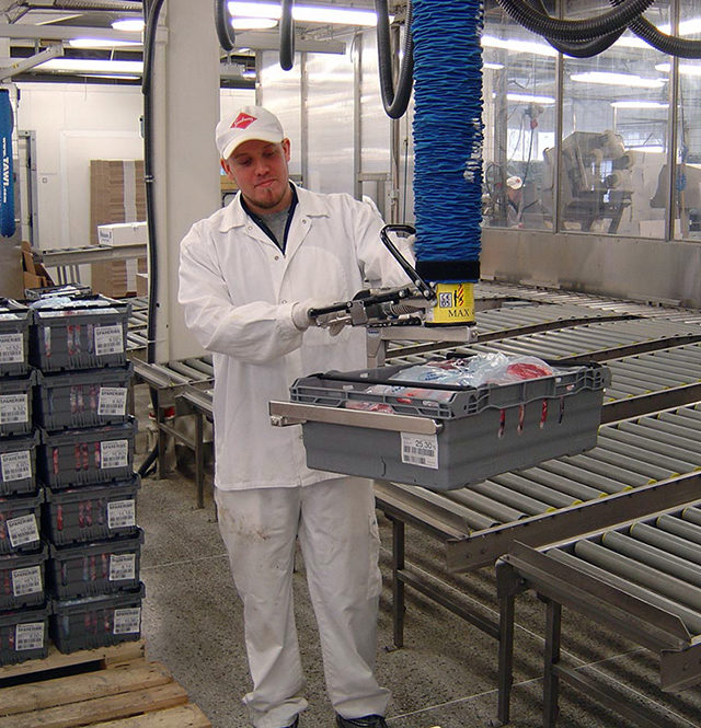 man lifting crate packed with meat