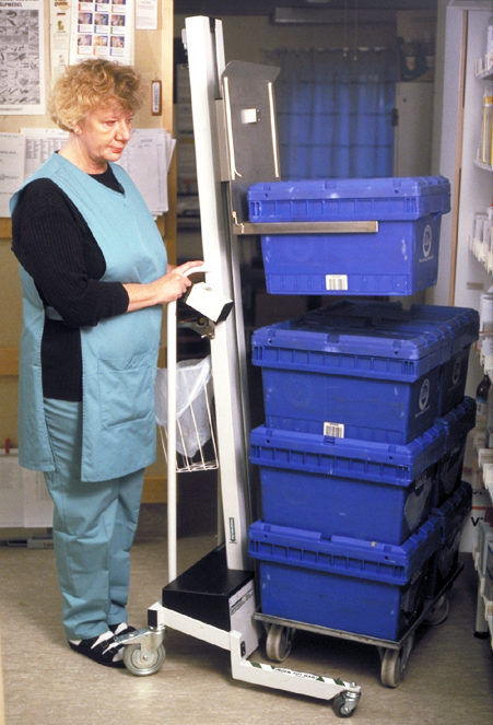 Lifting crates stacked on lifting trolley