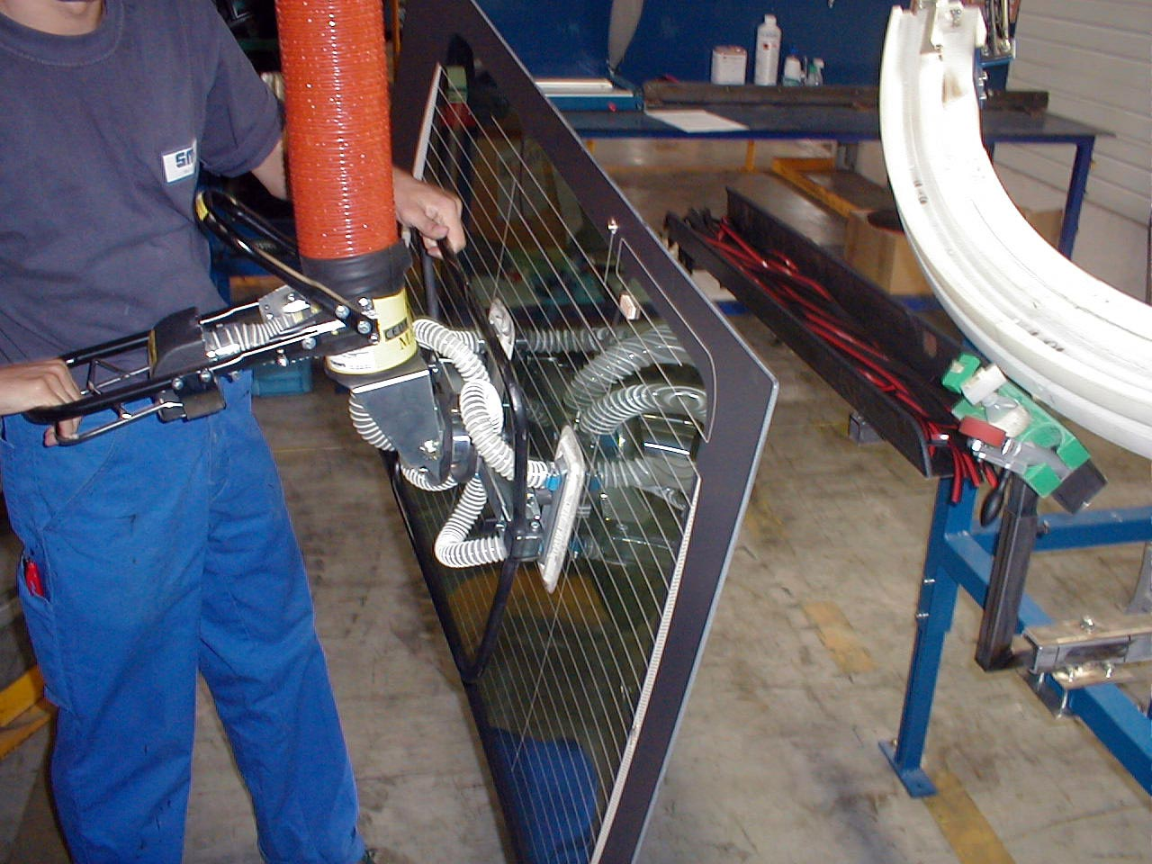 lifting windshield in automotive assembly line