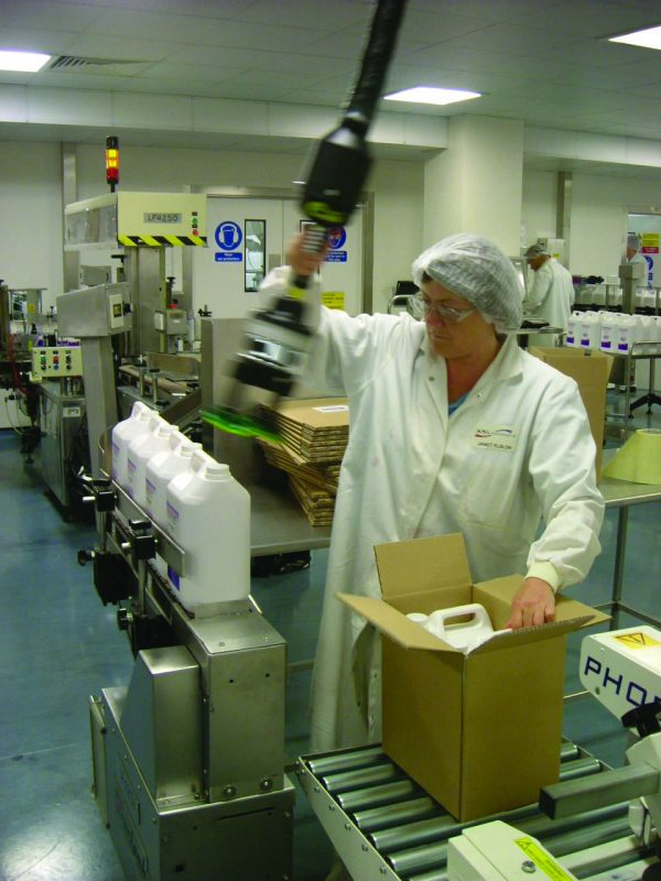 Lifting cannisters into boxes using handheld vacuum lifter