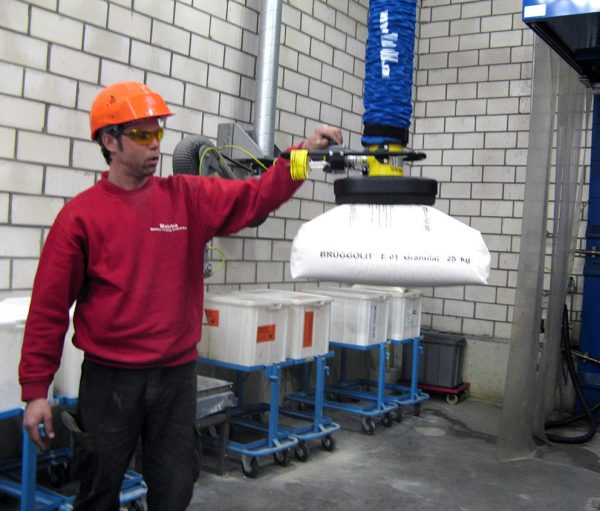 man lifting plastic sack with handheld vacuum lifter