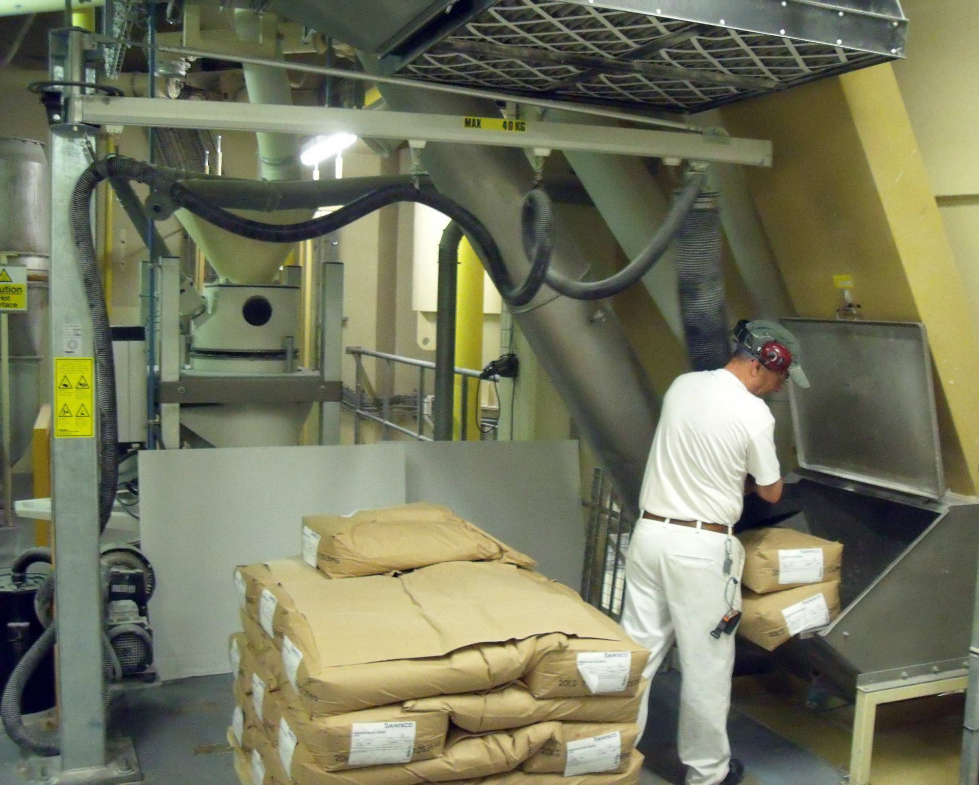 lifting sacks in pharmaceutical weigh room