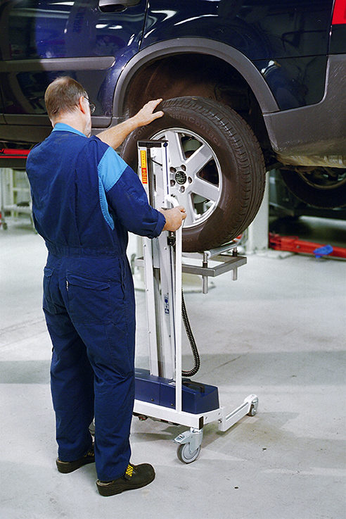 lifting and mounting car tyre using lifting trolley