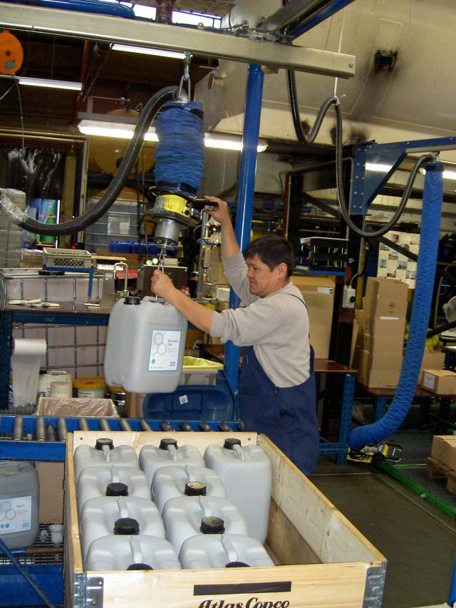 lifting cannisters onto pallet using vacuum lifter