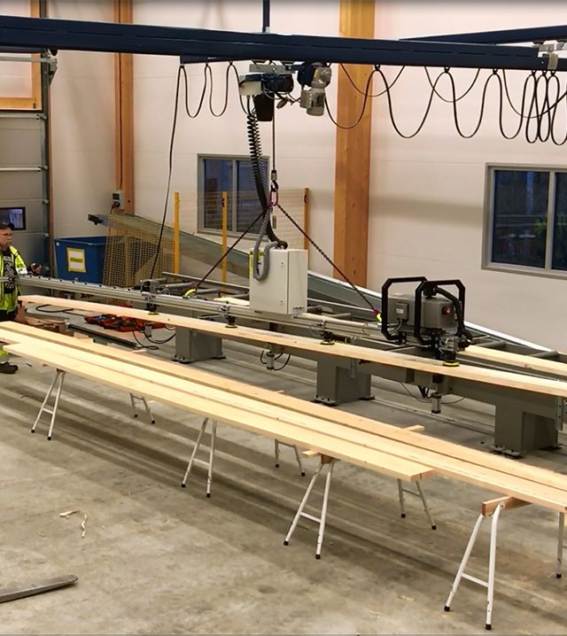 Lifting heavy wooden planks with hoist lift