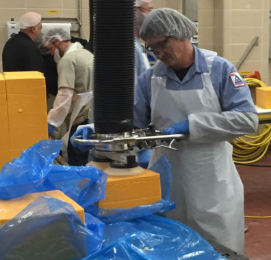 Lifting unwrapped cheese with stainless steel lifters