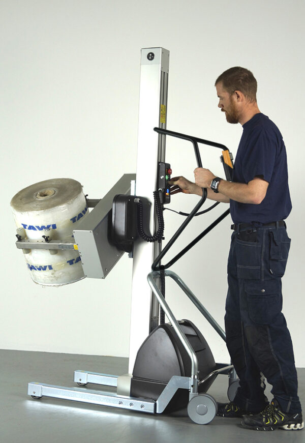 Man lifting and rotate big plastic using a handhold trolley