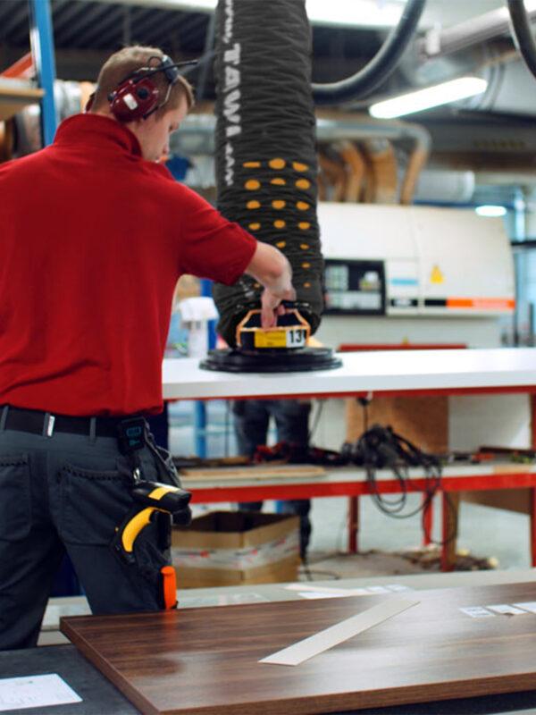 man lifting sheet with vacuum lifter
