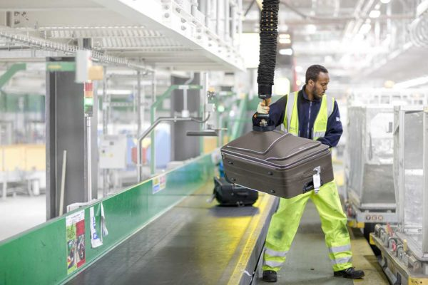 Lifting baggage at airport terminal