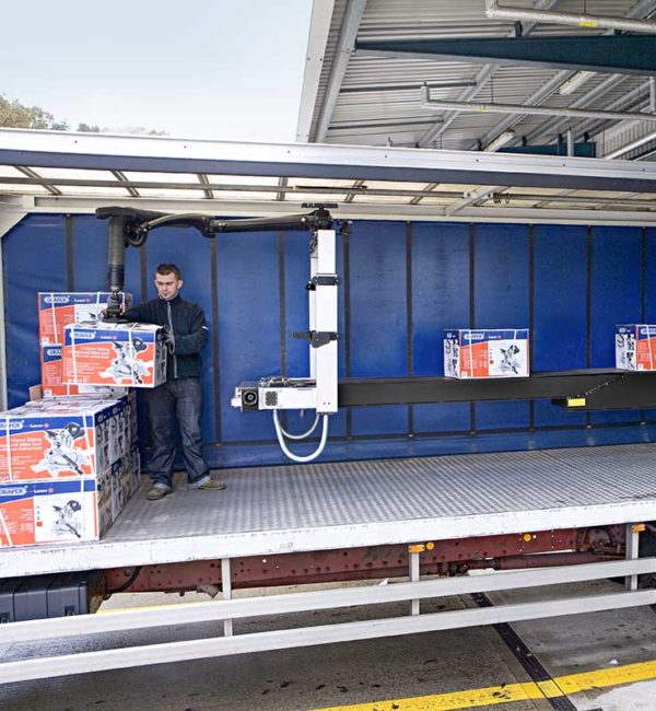 Unloading trailer with telescopic conveyor and vacuum lifter