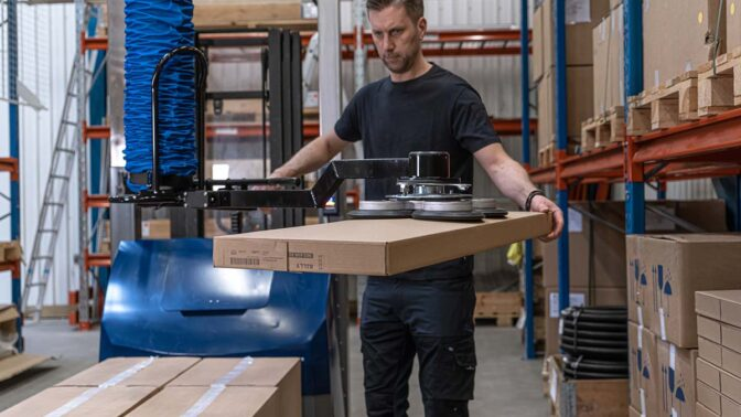 Mobile order picker with tool for extended reach into pallet racks